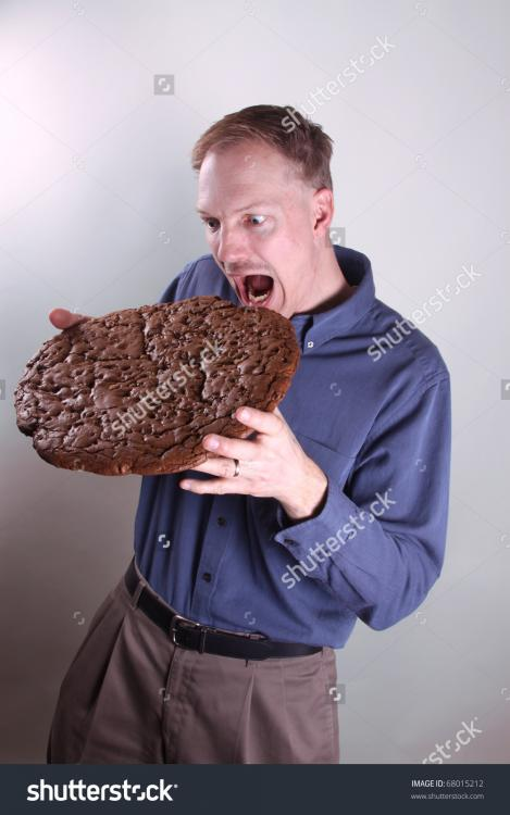 stock-photo-hungry-man-eating-a-giant-cookie-68015212.jpg